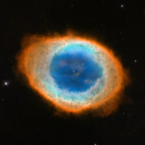 The Ring Nebula is formed from the discarded shell of a dying star. The star itself can be seen at the center of the image.