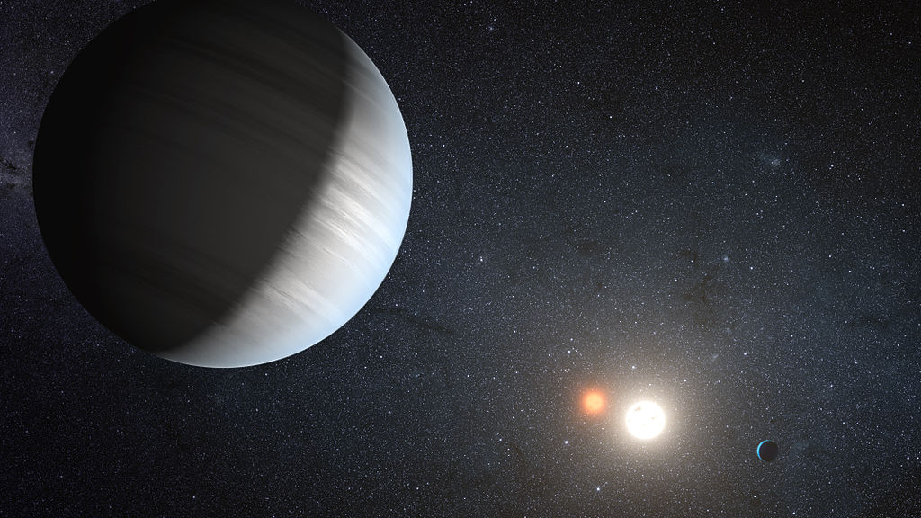 An artist's concept of Kepler-47, the first discovery of multiple planets orbiting two sun. Image credit: NASA/JPL-Caltech/T. Pyle